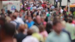 Crowd of anonymous people walking on city street sidewalk - stock footage