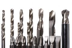 set of drill bits isolated in white - stock photo