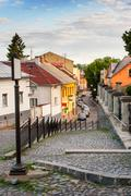 Curve cobbled streets of the old town goes down Stock Photos