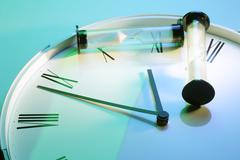 sand glass on clock - stock photo