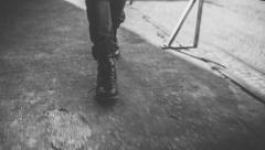 Walking With Boots in Urban Area Stock Footage