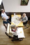 Residents seated in the dining hall of a nursing home Stock Photos