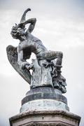 fallen angel, devil figure, bronze sculpture with demonic gargoyles and monst - stock photo