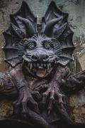 Devil figure, bronze sculpture with demonic gargoyles and monsters Stock Photos