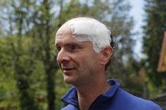 portrait of a man, 45, with an adhesive bandage on his head, geretsried, bava - stock photo