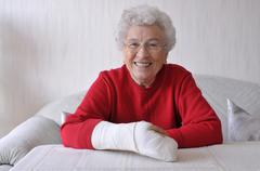 Senior woman, her right hand in a cast Stock Photos
