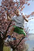 33 year-old man jumping in the city in spring Stock Photos