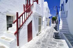 typical stairway entrances in a narrow alley in mykonos, cyclades, greece, eu - stock photo