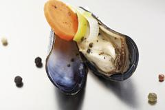 rhenish blue mussels, leek, carrots, onions, peppercorns - stock photo