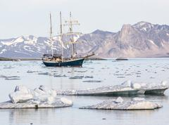 Yacht in the Arctic fjord - Spitsbergen, Svalbard - stock photo