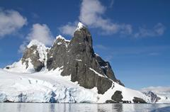 several peaks in the antarctic island in a sunny day - stock photo