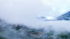 Morning mist among the mountain and village. - stock footage
