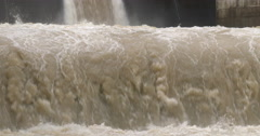 4K / HD Flood Water Flows From Dam Hydroelectric Plant - stock footage