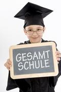 7 year-old boy holding a slate, small blackboard, gesamtschule, comprehensive Stock Photos