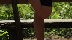 Runner stretching his leg in beautiful nature Stock Footage