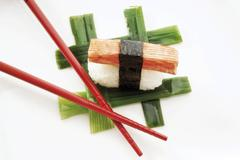 sushi nigiri, made with imitation crab meat and rice wrapped in nori seaweed  - stock photo