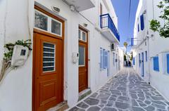 narrow alley with red wooden doors, naxos, cyclades, greece, europe - stock photo