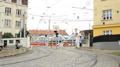 Entrance to the tram garage - gate - man walking around and smoking Stock Footage