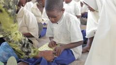 Blind boy reading braille alphabet. Zanzibar. Africa. - stock footage