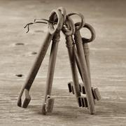 Old and rusty keys, in sepia tone Stock Photos
