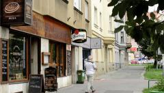 Restaurant(pub) exterior - man leave the restaurant - urban street: cars in back Stock Footage
