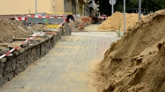 repair the urban street - grit, bricks - pavement  - stock footage
