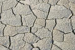 dry splited ground surface, aridity - stock photo