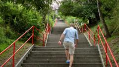 Man goes up the stairs - nature - shot from below Stock Footage