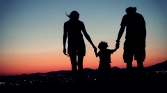 Family walking at sunset Stock Footage