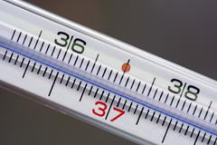 clinical thermometer 37 degree celsius - stock photo