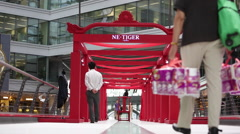 Customers walk through a red gallery at a shopping mall Stock Footage