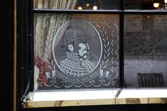 Window of sherlock holmes pub in london, england Stock Photos