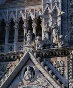 Detail of the facade of the cathedral santa maria assunta, siena, tuscany, it Stock Photos