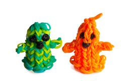 halloween rubber bands happy ghosts orange and green - stock photo