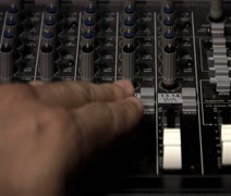 Adjusting levels on audio mixer Stock Footage