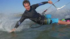 SLOW MOTION: Kiteboarder hand drag close up - stock footage