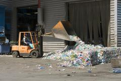 delivered plastic bottles are being transported into the sorting station, whe - stock photo