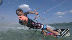 SLOW MOTION: Kiteboarder having fun kiting - stock footage