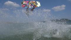SLOW MOTION: Kitesurfer extreme jumping trick Stock Footage