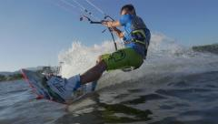SLOW MOTION: Kiteboarder jumping backroll trick Stock Footage