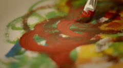 Painting with gouache on the peace of paper, art, culture, expression Stock Footage
