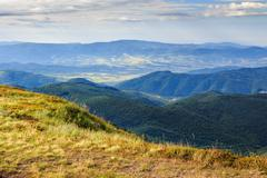 steep precipice of mountain with yellowed grass - stock photo