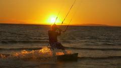 SLOW MOTION: Kiteboarder riding at sunrise - stock footage