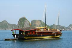 traditional vietnamese junk boat in halong bay viet nam - stock photo