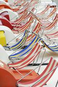 Stock Photo of paddleboats with colorful striped seats