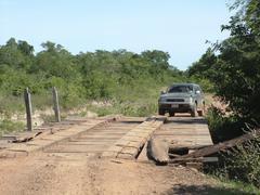 Stock Photo of driving on a ruinous wooden bridge, concepcion, paraguay