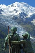 Balmat and saussure monument, bossons glacier and dome du gouter, chamonix, f Stock Photos