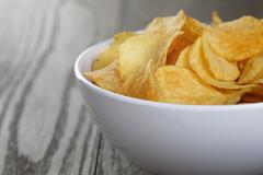 Potato chips with paprika Stock Photos