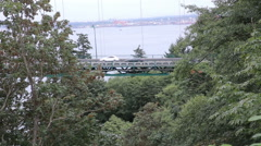 Cars passing by the lions gate bridge in Vancouver Stock Footage