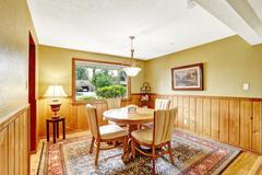dining room in log cabin house - stock photo